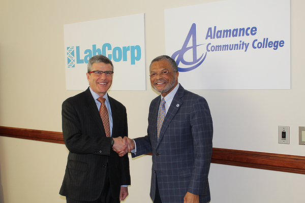LabCorp CEO David King and Alamance Community College President Algie Gatewood