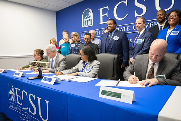 Officials sign articulation agreement in aviation science.