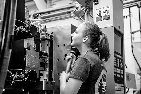 Apprentice examines equipment