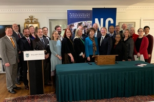 NCCCS President Peter Hans and NCICU President Hope Williams stand with representatives of colleges that signed articulation agreements.