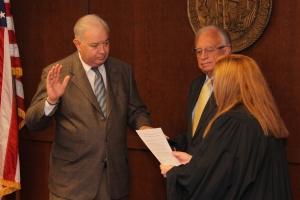 Ernest C. Pearson, receives oath of office during July 2014 State Board meeting.