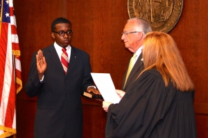 La'Quon Rogers, receives oath of office during July 2014 State Board meeting.