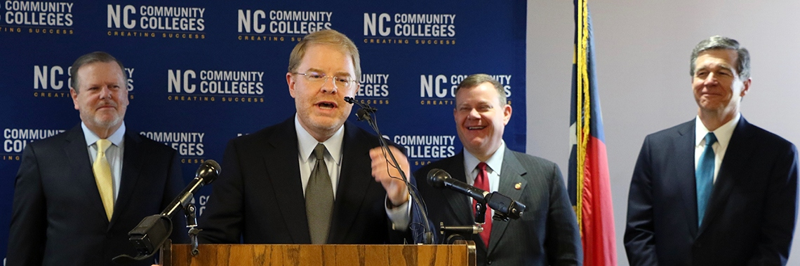 Peter Hans speaks at a news conference.